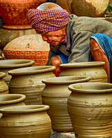 A Man Among His Pots Burma  2